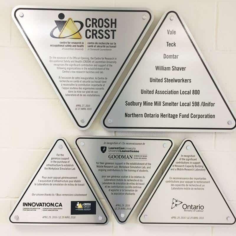 Plaques listing CROSH sponsors