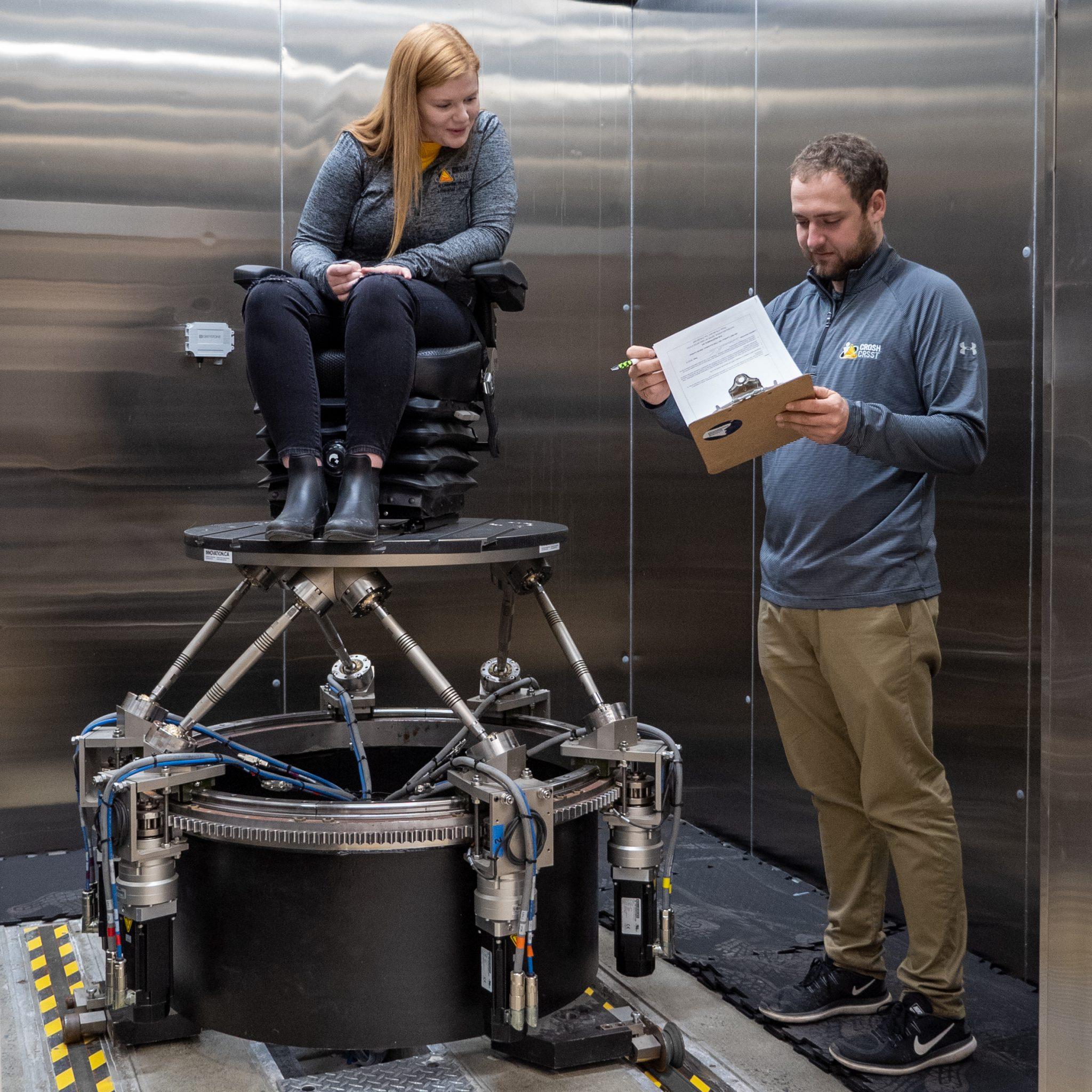 Researchers using the W-SIM robotic platform