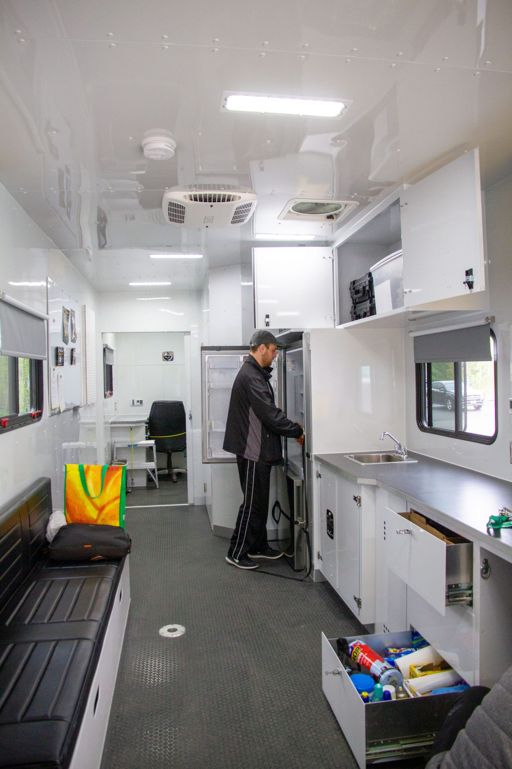 Workplace simulator technologist Wesley Young packing the fridge in the mobile research lab