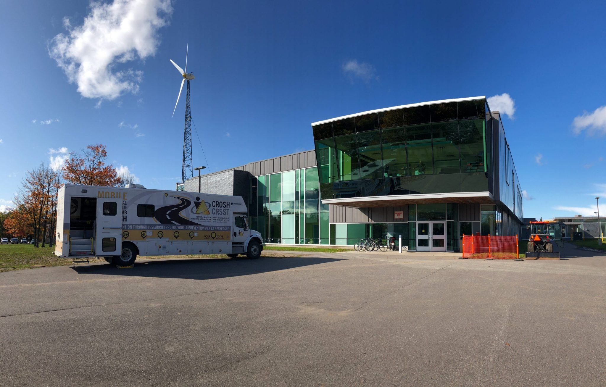 Mobile research lab (M-CROSH) parked in front of a building at Sault College