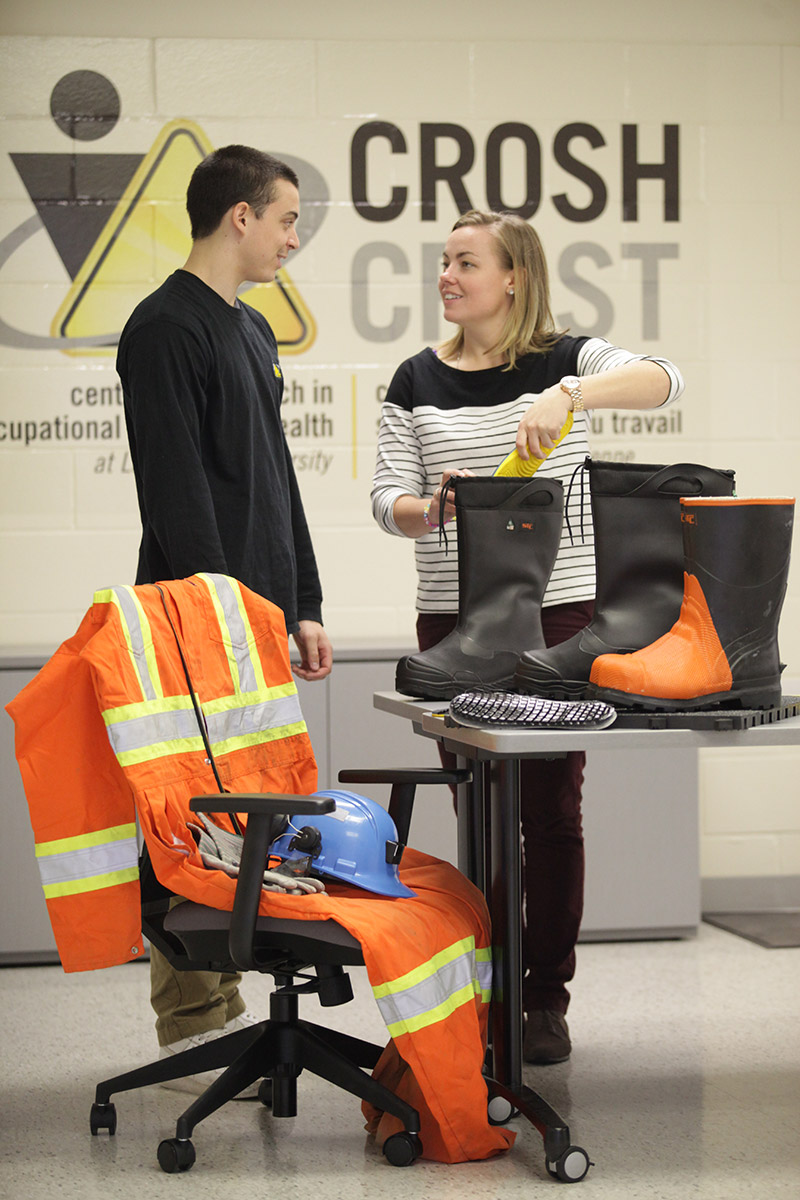 Man and woman examining safety equipment