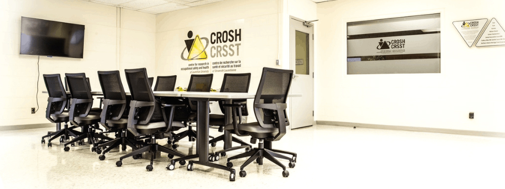 Chairs around a meeting table in the CROSH lab in the Ben Avery Building