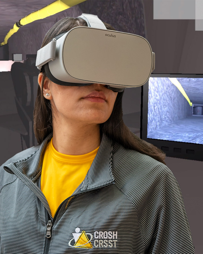 Woman wearing a virtual reality headset superimposed over a virtual mine drift
